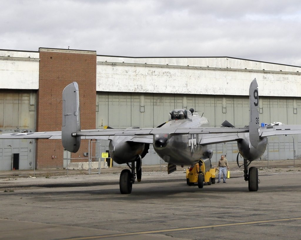 A B-25 bomber rests in front of the former Willow Run Bomber Plant in Ypsilanti Township, Mich., Thursday.The plant was where Rose Will Monroe helped build B-24 Liberator bombers during World War II.