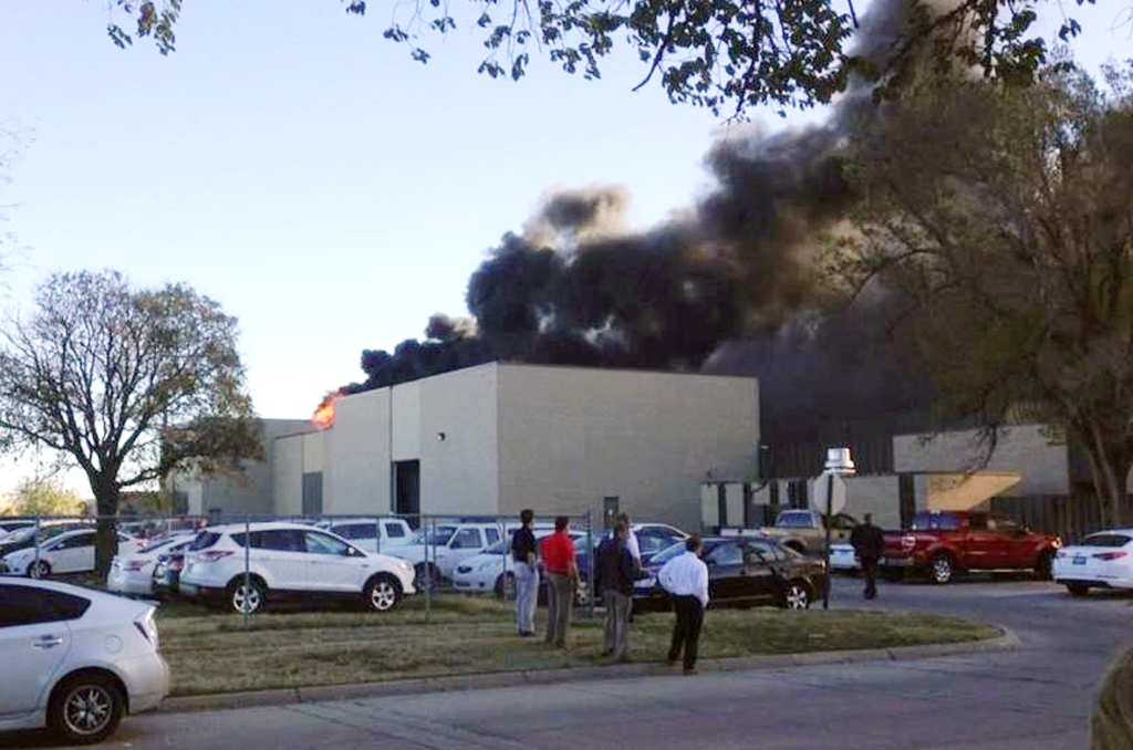 A fire official says at least two are dead inside this building at the Mid-Continent Airport in Wichita, Kansas, where  a small plane crashed Thursday. The Associated Press / KAKE News