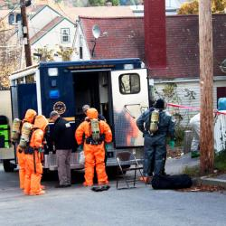 Police collect evidence at a building in Bath where they say two suspects were operating a meth lab, in October 2014.