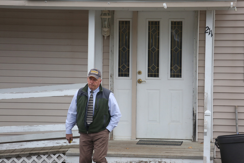 "Fort Kent Police Chief Thomas Pelletier leaves the home of Kaci Hickox and Ted Wilber Friday morning, saying ""We just had a good morning conversation."""