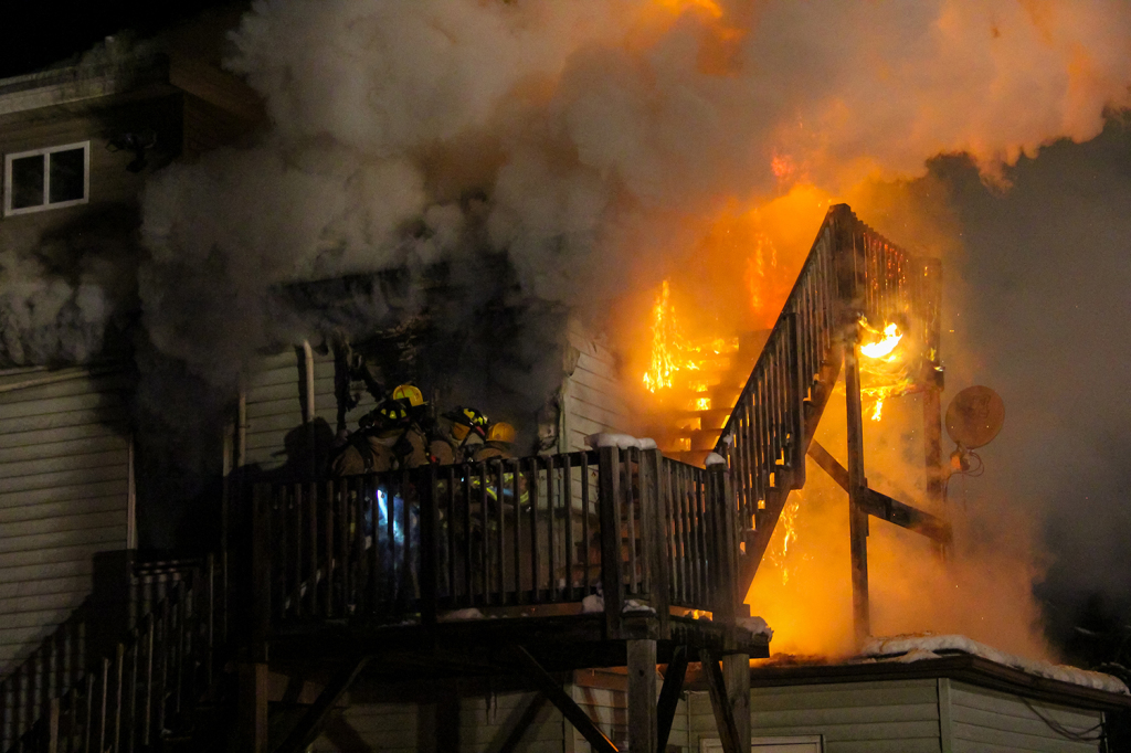 Firefighters make their way into a second floor apartment late Friday night during a 2nd Alarm fire on Old Pine Hill Road South in Berwick. Photo courtesy of Shawn St.Hilaire