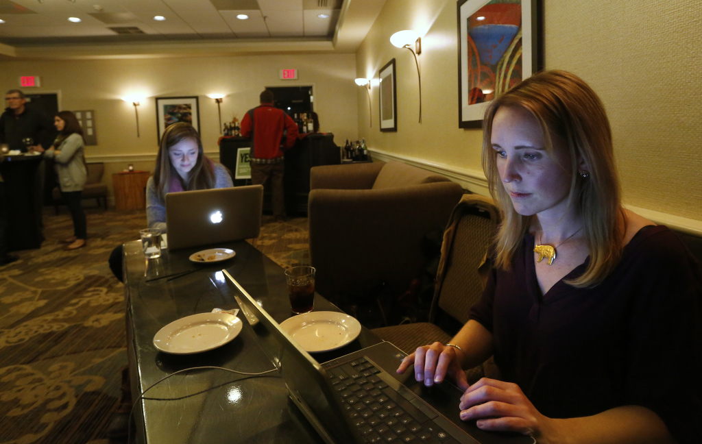 Campaign director Katie Hansberry and campaign manager Stephanie Harris work at the Yes on 1 campaign headquarters at the Embassy Suites hotel in Portland. Question 1 asked voters whether they want to ban certain bear hunting practices in Maine.
