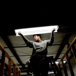 Ryan Lambert of  Superior Electrical Contracting installs new, efficient light bulbs at Cuddledown in Yarmouth Wednesday, November 12, 2014.