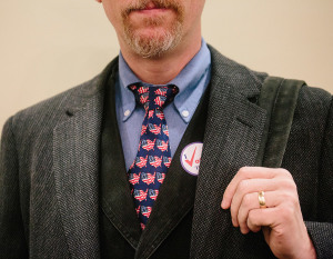 "Gerard Giordano dons a United States flag tie and an ""I Voted"" sticker after participating in the Maine midterm elections at the Italian Heritage Center in Portland, ME."