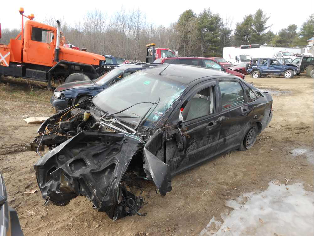 A West Gardiner teen apparently lost control of the car he was driving, breaking off a utility pole at the ground and rolling the car over several times. The impact tore the engine from the car. Photo courtesy of the Maine Department of Public Safety