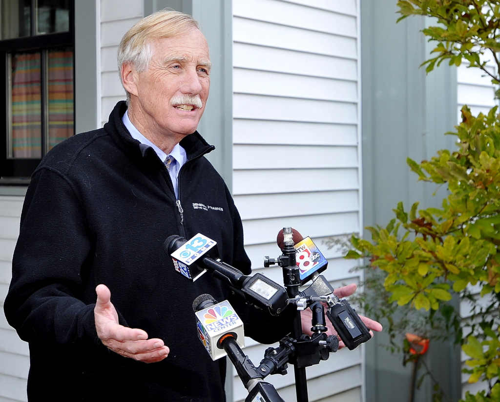 U.S. Sen. Angus King speaks outside his home in Brunswick on Wednesday to announce he will caucus with the Democratic Party.