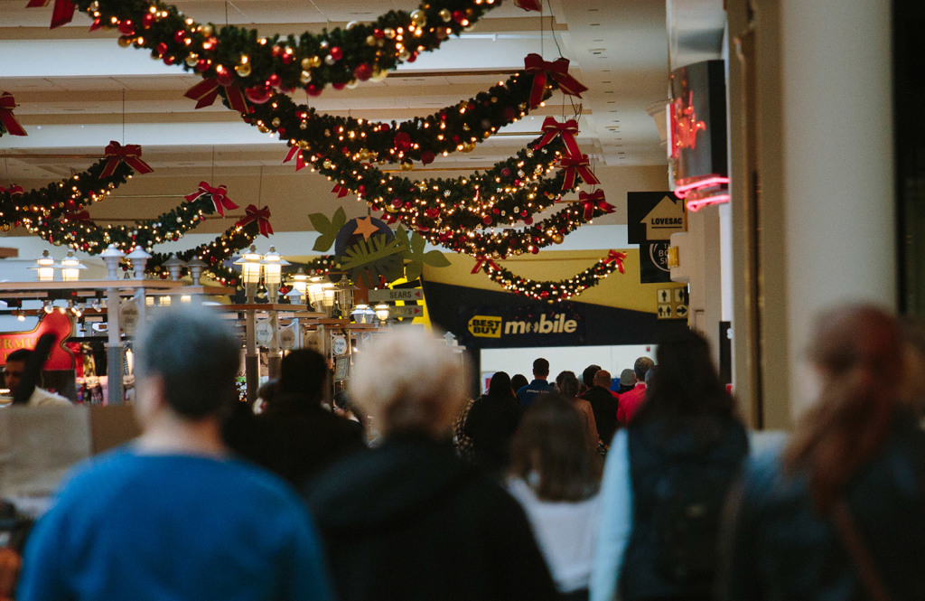 Shoppers walk through a busy area at the Maine Mall in South Portland on Tuesday. While many malls in America are slumping because of Internet sales, the Maine Mall has kept a high occupancy rate.