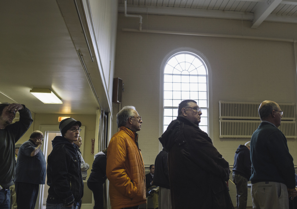 Voters wait to cast their ballots at Woodfords Congregational Church in Portland on Tuesday.