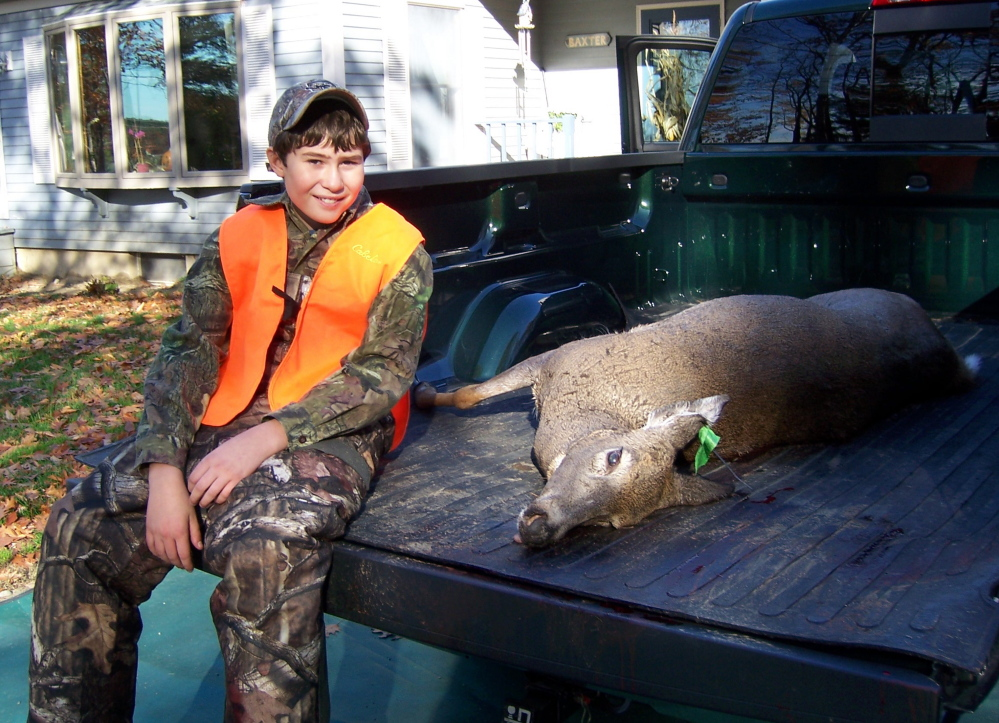 Cameron Couture, 11, of Wilton felled his first deer with one shot on Youth Deer Day. Deer season opens for Maine residents Saturday and for non-residents Monday.