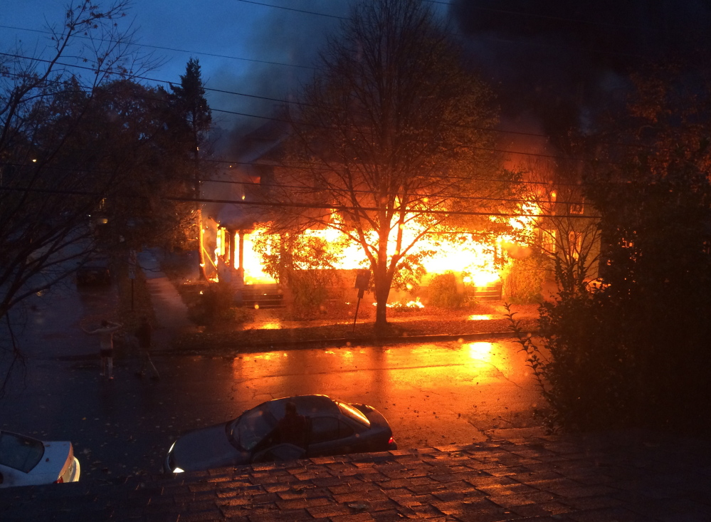 Flames engulf a Noyes Street apartment building in this photo taken shortly after the fire started around 7 a.m. Saturday. Witnesses said the fire may have originated on a porch, and investigators say they'll try to determine if there are traces of an accelerant.