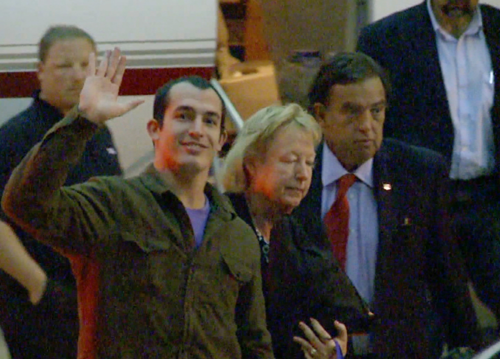 Marine Sgt. Andrew Tahmooressi waves after arriving in Miami on Saturday. Tahmooressi is back home after a Mexican judge ordered his release from jail, where he spent eight months for crossing the border with loaded guns.