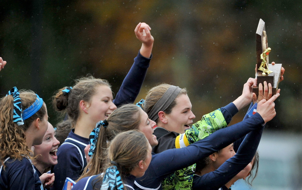 York celebrates the Class B field hockey championship Saturday with a 2-1 victory against Gardiner.