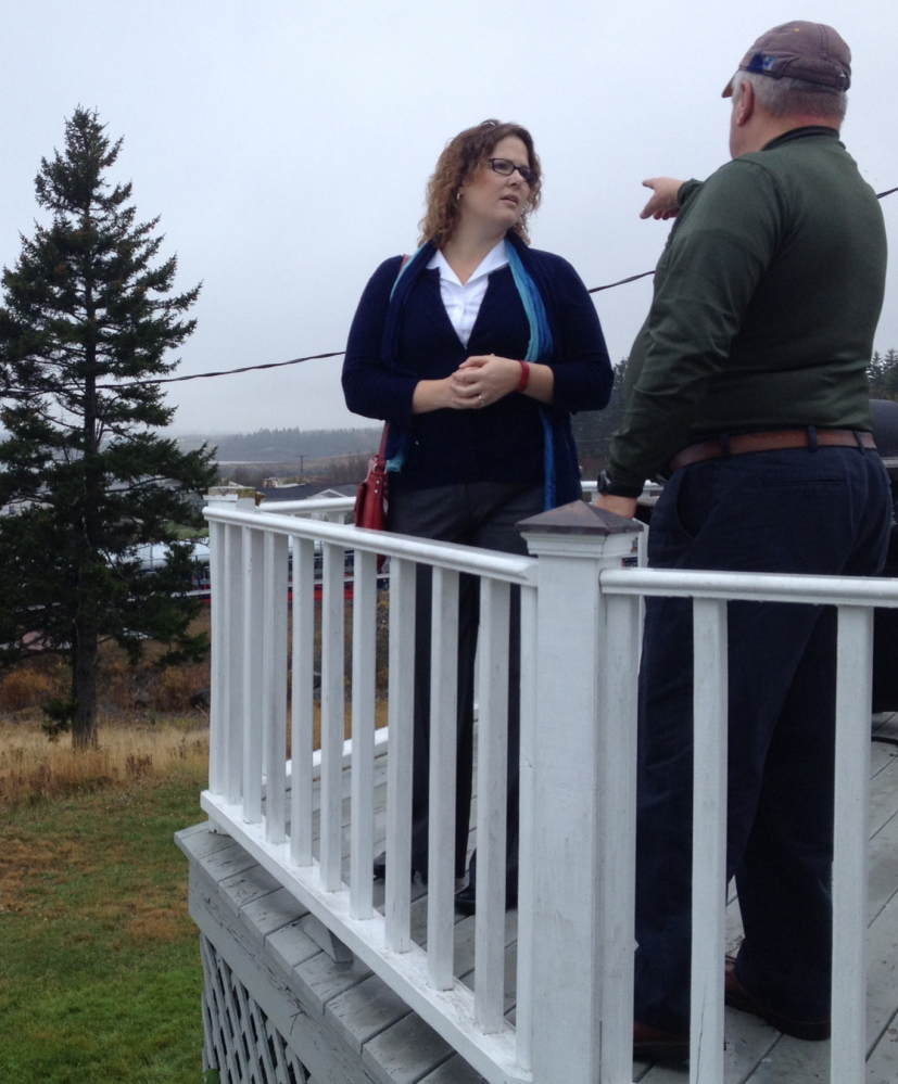 Democratic 2nd District candidate Emily Cain speaks with Bob Peacock, a harbor pilot, during a recent campaign swing through Eastport.