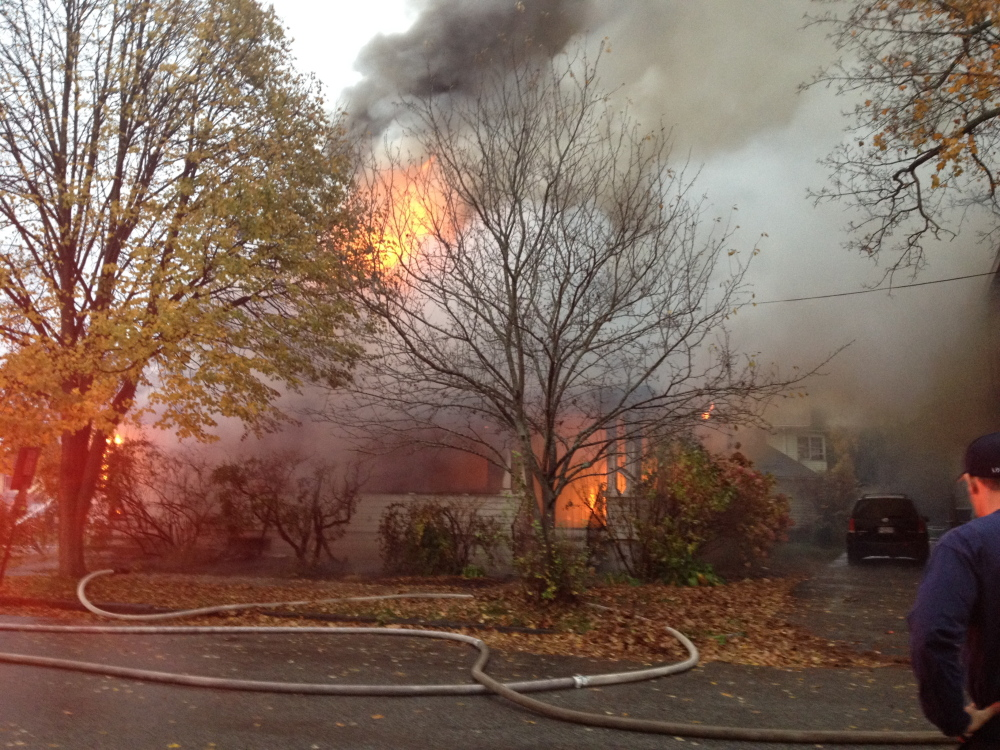 A fire rages at a house on Noyes Street in Portland on Saturday morning.