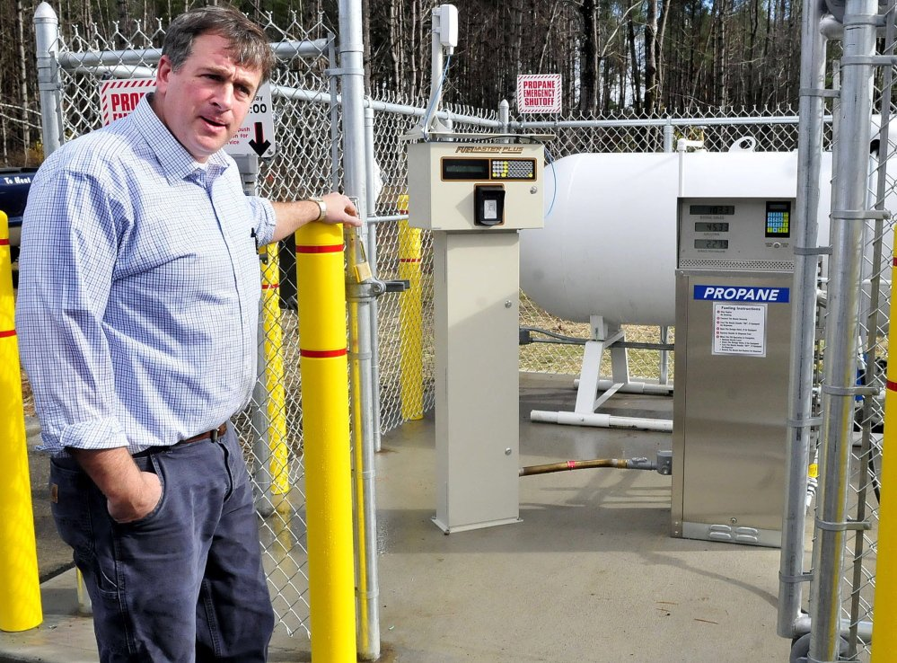 Robert Shibley, owner of Bob's Cash Fuel business in Madison, speaks about offering propane fuel for vehicles beside pumps and meters for the product on Thursday, Oct. 30, 2014.
