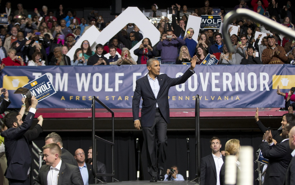 President Obama walks on stage at a Philadelphia rally Sunday for gubernatorial candidate Tom Wolf, who is trying to unseat Republican Gov. Tom Corbett.