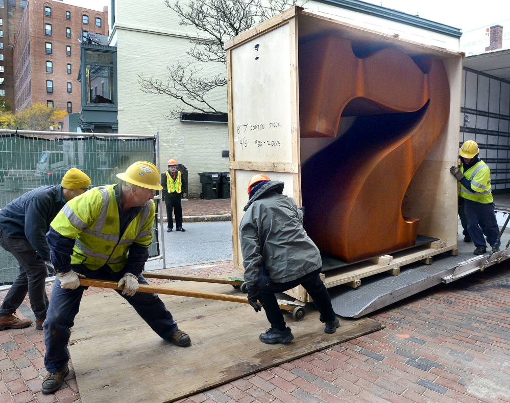 "Workers get ready to install the ""Seven"" sculpture by Robert Indiana outside of the Portland Museum of Art. ""This is a public announcement that 7 Congress Square will always be a place for art,"" the chief curator says"