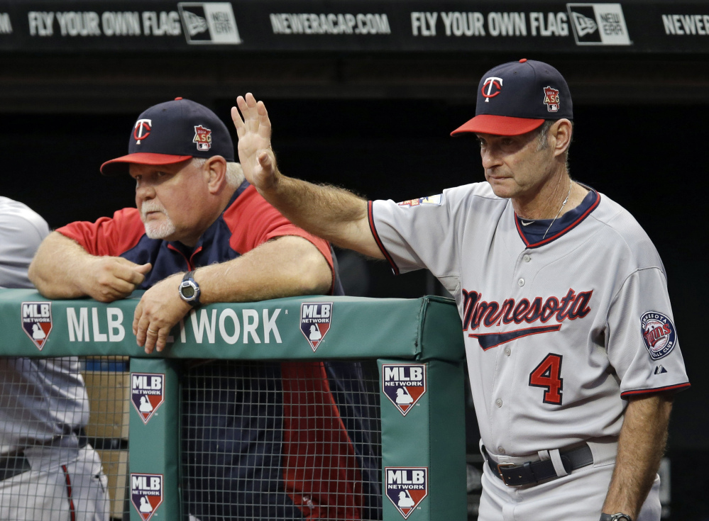 Paul Molitor (4), seen coaching the Minnesota Twins with manager Ron Gardenhire in September, will be introduced as the team's new manager Tuesday and given a three-year contract, replacing Gardenhire.