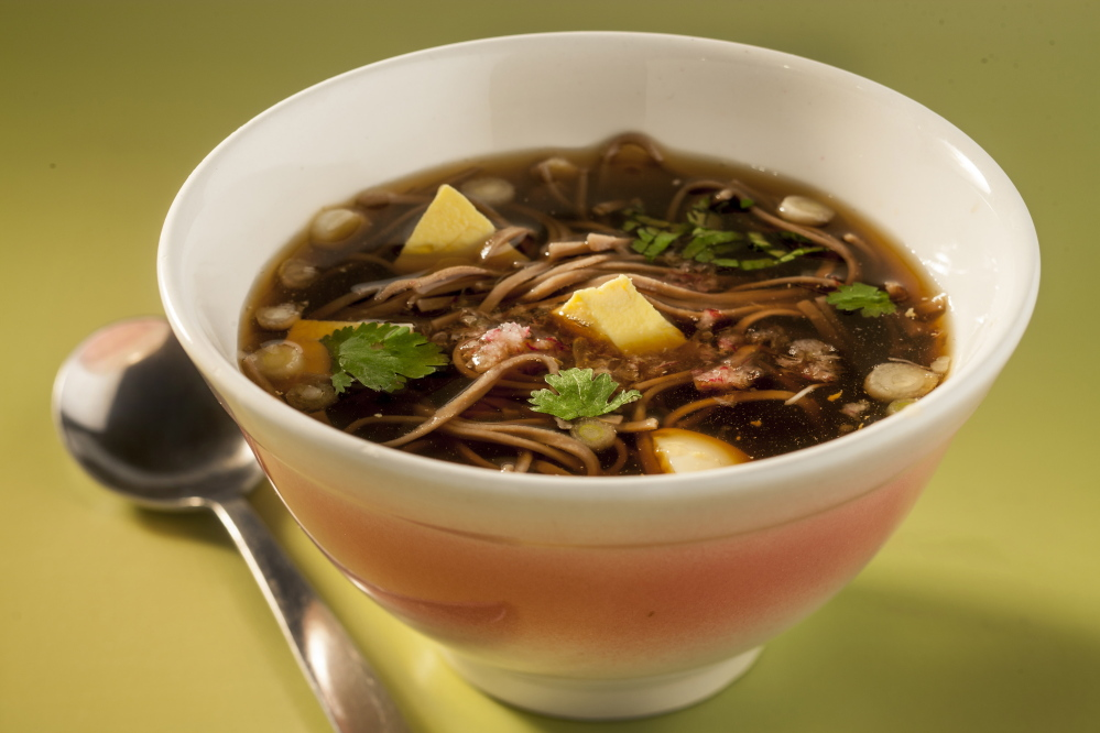 Tsuyu is a simple soup of dashi, mirin and soy sauce. Pour over cold soba noodles and serve as is or garnished with cilantro, sliced green onion, cubed tofu, hard cooked egg or grated radish.