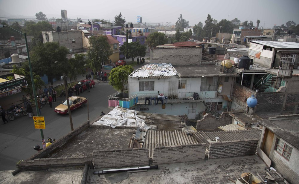 A view of one of several homes that police raided in their search for fugitive mayor of Iguala, Jose Luis Abarca, and his wife, Maria de los Angeles Pineda, in the Iztapalapa neighborhood of Mexico City on Monday.