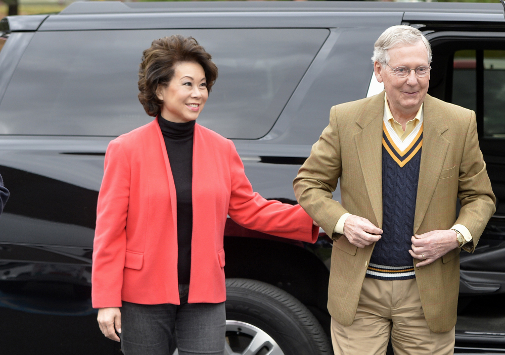 Senate Minority Leader Mitch McConnell of Kentucky and his wife, Elaine Chao, arrive at Bellarmine University Louisville, Ky., Tuesday, to cast their votes.