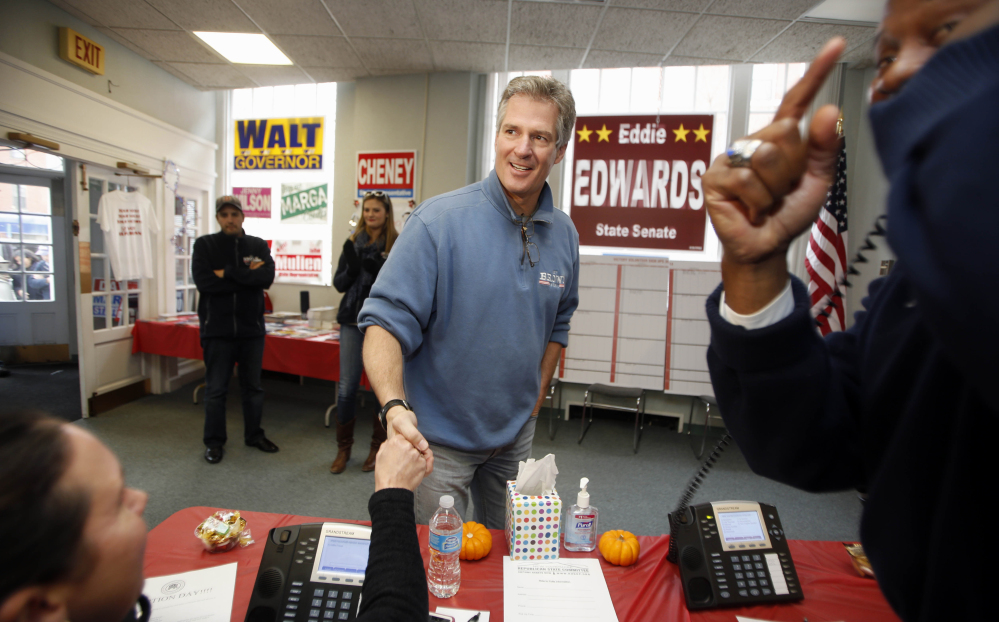 New Hampshire Republican Senate candidate Scott Brown greets volunteers on election day from the Republican field office, Tuesday, Nov. 4, 2014, in Dover, N.H. Brown is trying to unseat incumbent U.S. Sen. Jeanne Shaheen.  (AP Photo/Jim Cole)