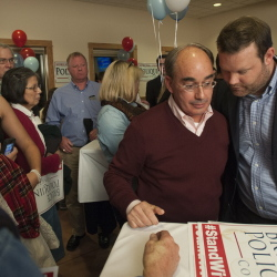 "Bruce Poliquin listens to campaign manager Matt Hutson while greeting supporters at Dysart's on Tuesday evening. In remarks, Poliquin said 2nd District residents ""will have someone working nonstop"" in Washington if he is elected."