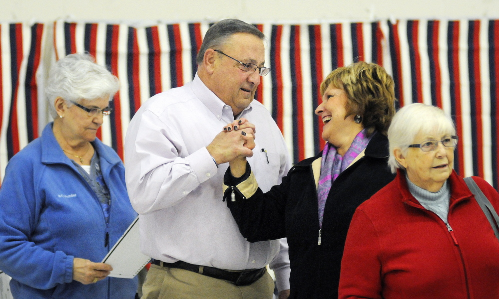 Gov. Paul LePage greets first lady Ann LePage after voting Tuesday in Augusta. A topic of speculation for his second term is whether he will govern with a less confrontational style than in his first four years.