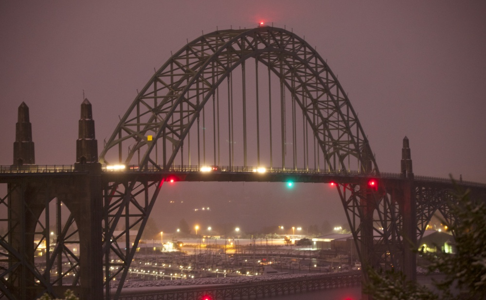 This Dec. 6, 2013 photo, shows the Yaquina Bay Bridge, Newport, Ore. A woman who appealed for money online to help care for her autistic son and disabled husband has been accused of throwing her 6-year-old boy to his death off the historic bridge on Monday.