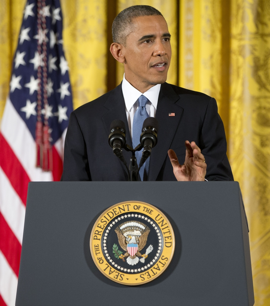 President Barack Obama speaks during a news conference in the East Room of the White House on Wednesday in Washington.