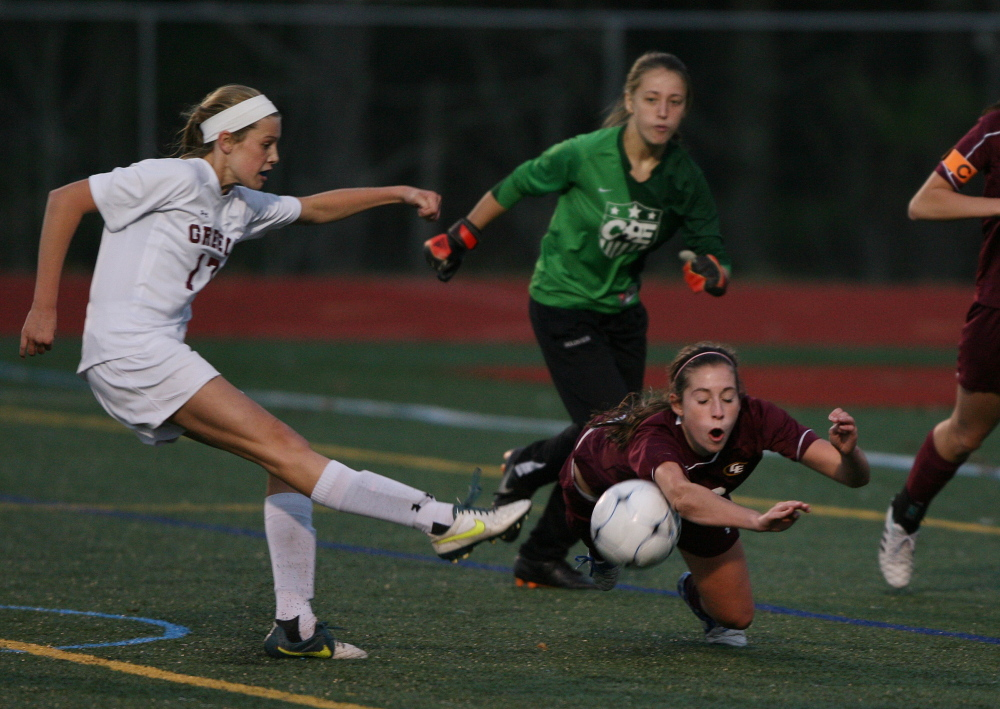 Cape Elizabeth's Morgan Wight, right, blocks Greely's Courtney Sullivan's shot as the goalie looks on during the second half of the Western Class B girls' soccer final on Wednesday in Yarmouth. Cape Elizabeth won 2-1 in penalty kicks.