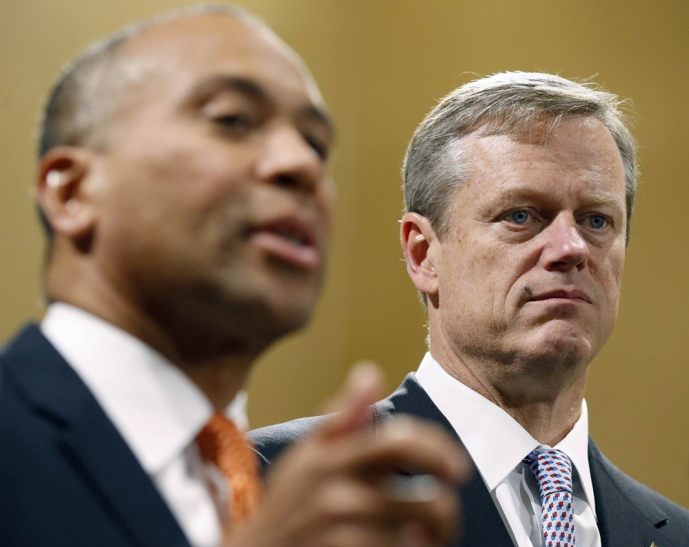 Gov. Deval Patrick, left, stresses the importance of a smooth transition for the incoming administration of Republican Charlie Baker, right, who narrowly defeated Martha Coakley.