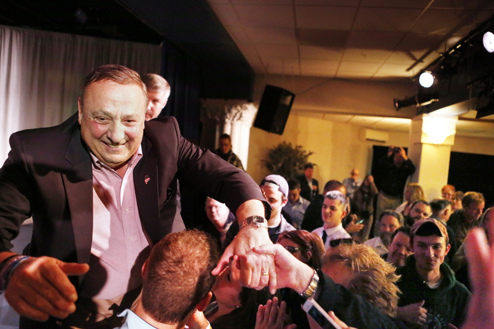 Gov. Paul LePage greets supporters after his acceptance speech early Wednesday during his campaign gathering at the Franco American Heritage Center in Lewiston.