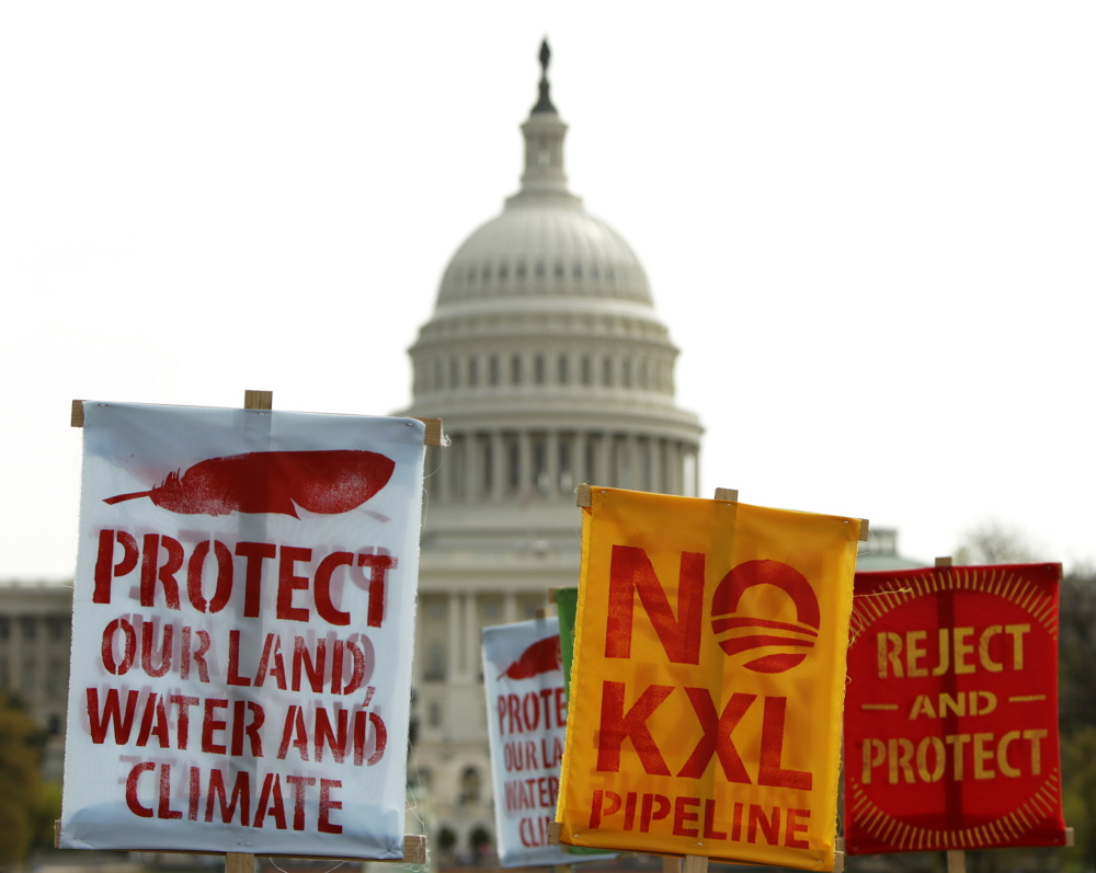 "Signs in front of the U.S. Capitol protest the Keystone XL pipeline earlier this year. One election analyst suggested the Obama administration might even approve the pipeline before January, ""to rob the GOP of an early-session victory lap."""