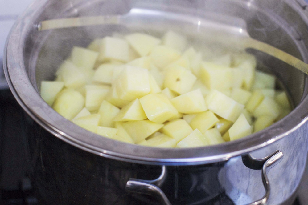 Sara Moulton's better mashed potatoes recipe calls for cooking the potatoes twice.