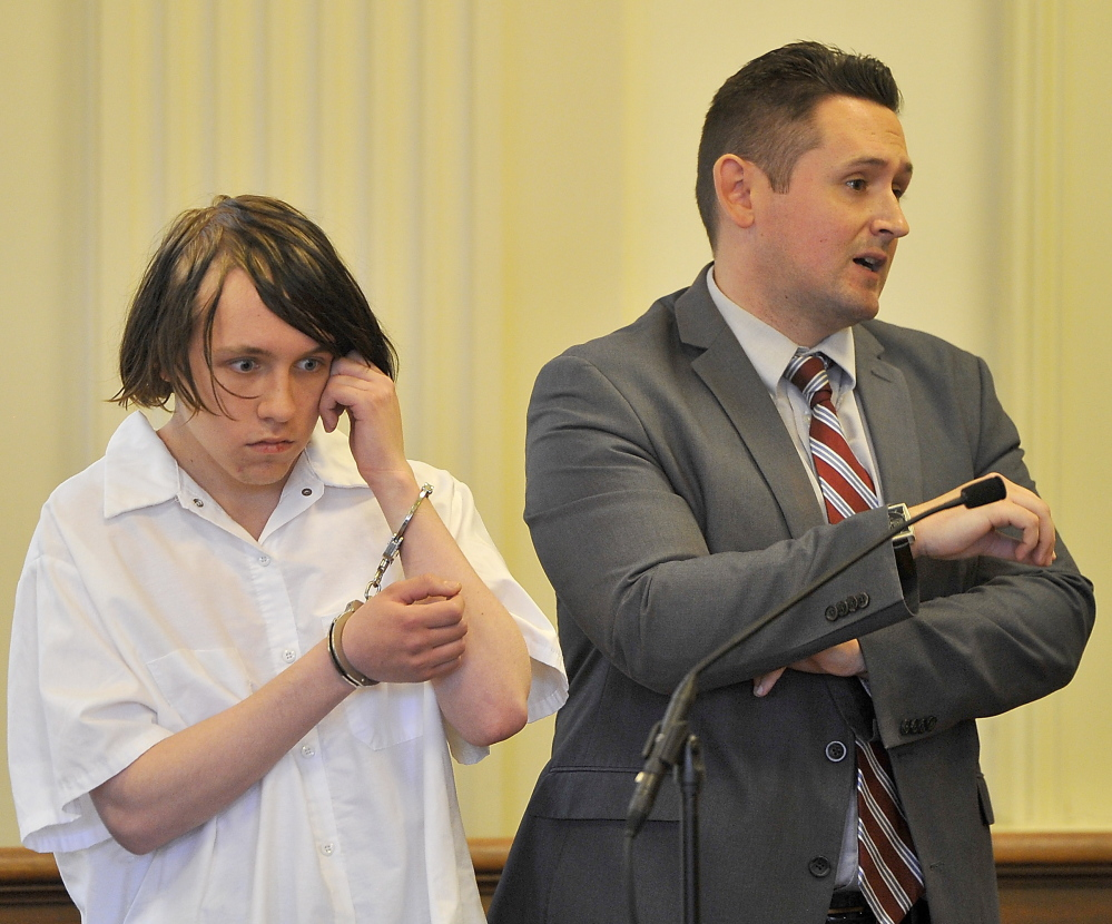 Dylan Lee Collins, 18, left, appears in York County Superior Court with his attorney Friday. James Ford, 21, and Michael Moore, 23, died from injuries sustained in the fire Collins is accused of setting on Sept. 18.