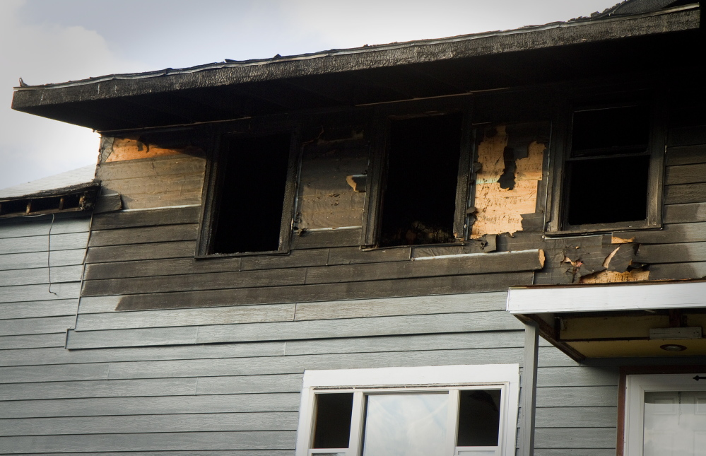 Investigators with the state Fire Marshal's Office determined that the fire at 35 Main St. in Biddeford was intentionally set in a stairwell connecting the first and second floors of the 17-unit apartment building.