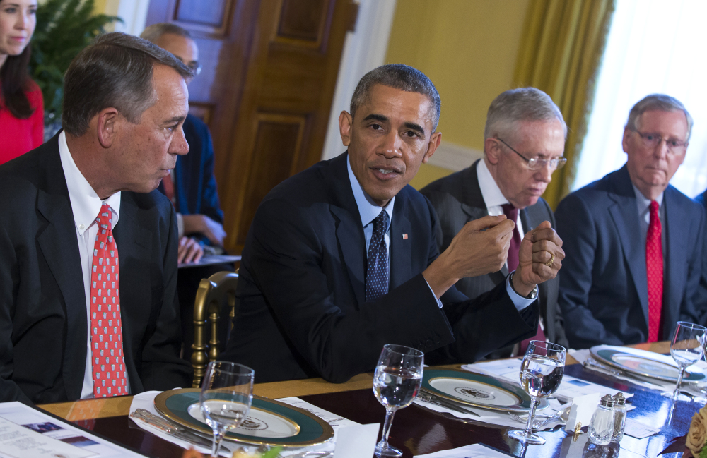 President Obama meets with Congressional leaders in the Old Family Dining Room of the White House in Washington on Friday.