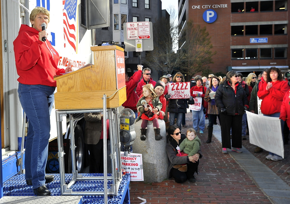 IBEW president, Diane Winton, speaks to the workers and supporters during the striking Fairpoint union workers rally at Monument Square on Saturday.
