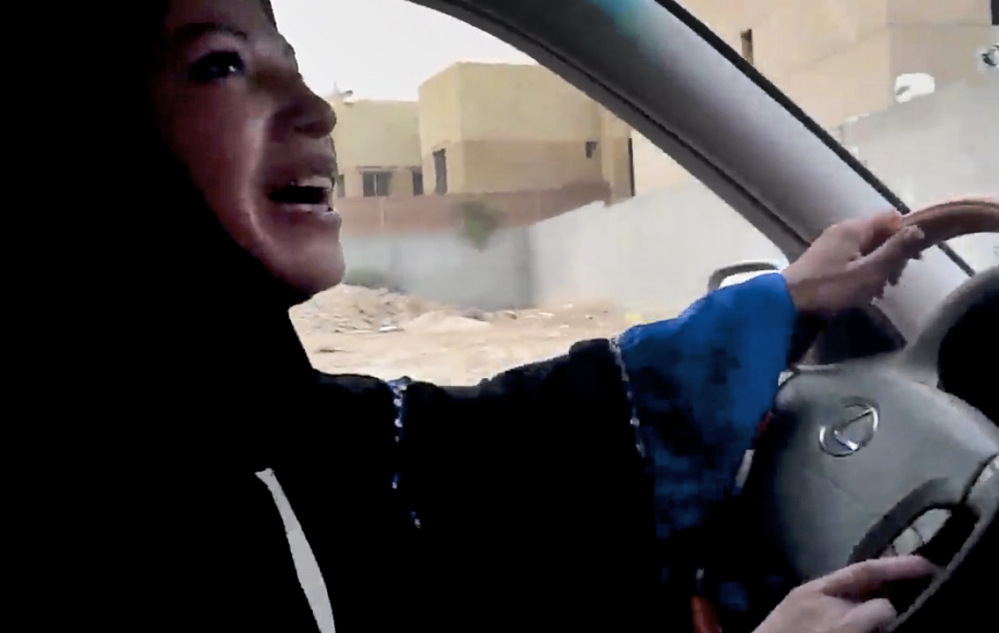 In image released by Change.org, a website used by activist groups, a Saudi Arabian woman drives a car as part of a campaign to defy Saudi Arabia's ban on the practice.