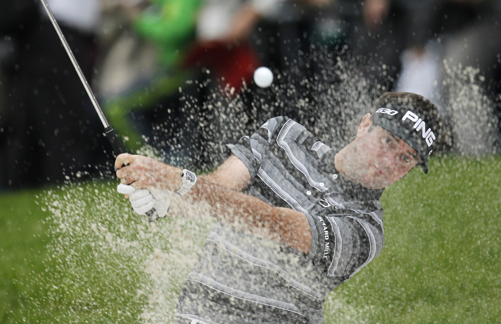 Bubba Watson of the U.S. hits a shot from a bunker on the 18th hole during the final round of the HSBC Champions at Shanghai on Sunday. Watson won in a playoff.
