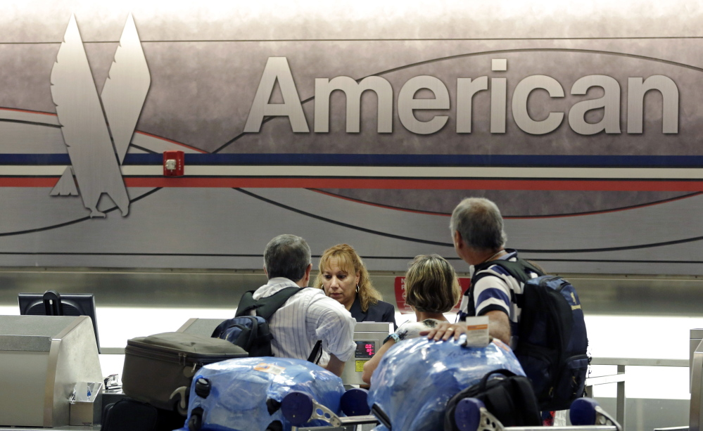 Flight attendants at American Airlines rejected a five-year contract Sunday, forcing the world's largest carrier and its union for cabin-crew workers into binding arbitration.
