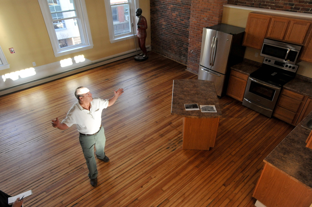 Charlie Giguere offers a tour of the penthouse apartment on the third floor of his newly renovated downtown Waterville building on Main Street. Giguere has turned upper floors of his business, Silver Street Tavern, into offices and apartments, furthering the view that upper floors downtown are good places to live and work.