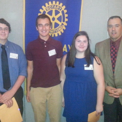 Rotary Club of Saco Bay president Chris Jacques with Students of the Month for October: Amanda Kimball of Biddeford High School; Daniel Picard of Thornton Academy in Saco; and Craig Finley of Old Orchard Beach High School.