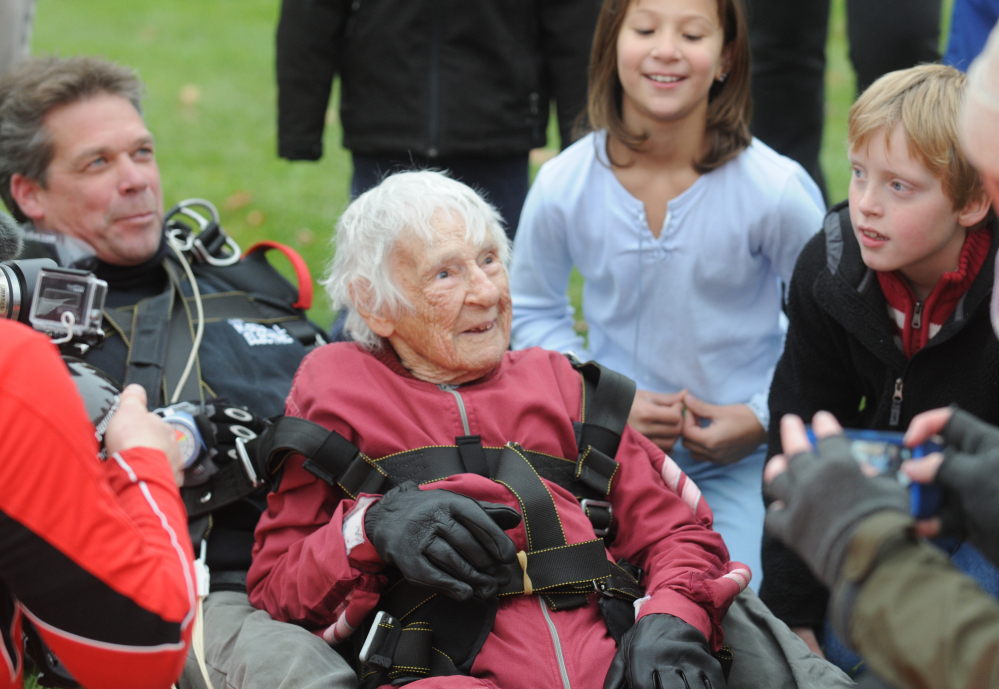 "Eleanor ""Nanny"" Cunningham, with tandem master Dean McDonald, are welcomed by Cunningham's friends and family after their skydive in Gansevoort, N.Y, on Saturday, a day after her 100th birthday. It was the third jump for Cunningham, who took up the sport when she was 90."
