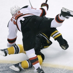 New Jersey right wing Michael Ryder heads for a tumble over Boston defenseman Dennis Seidenberg during the Bruins' 4-2 win over the Devils on Monday at Boston. One highlight for the Devils: Jaromir Jagr scored his 708th goal, tying him with Mike Gartner for sixth on the NHL list.