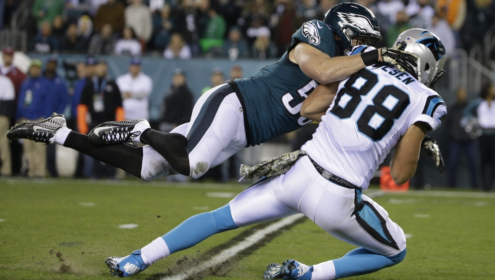 Carolina's Greg Olsen, 88, is tackled by Philadelphia's Casey Matthews after catching a pass in the first half of their game Monday in Philadelphia.