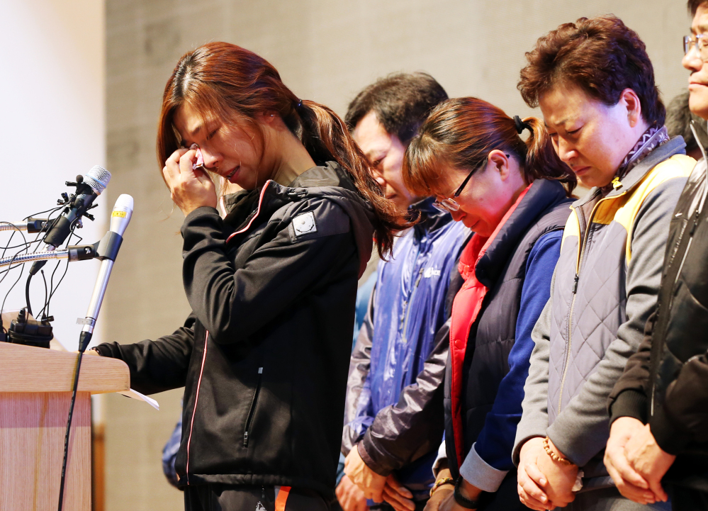Relatives of the nine missing passengers of the sunken ferry Sewol cry during a news conference at a gym on South Korea's southwestern island of Jindo, where they have been staying at since the April 16 sinking of ferry Sewol, in Jindo, South Korea. A South Korean court on Tuesday handed a 36-year prison sentence to the captain of a sunken ferry.