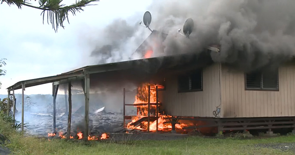 In this image from video provided by the County of Hawaii, lava flow from the Kilauea Volcano burns a residential structure Monday in Pahoa, Hawaii. A stream of lava set a home on fire Monday in a rural Hawaii town that has been watching the slow-moving flow approach for months. The home's renters already had left the residence in Pahoa, the largest town in the Big Island's isolated and mostly agricultural Puna district.