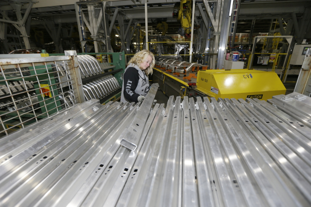 Jennifer Gillesbie works on the frame of the new Ford F-150 truck. Aluminum isn't new to the auto industry, but this is the first time it will cover the entire body of such a high-volume vehicle.